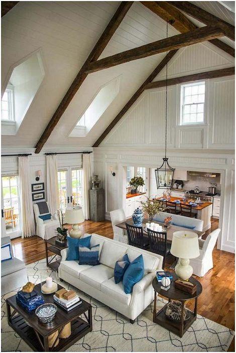 Ogromna przestrzeń życiowa, którą uzupełniają drewniane belki, które idealnie wpisują się w duży obraz.