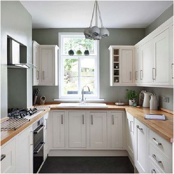 Хубава кухня в спокойни сиви и бели цветове - проста и сладка.