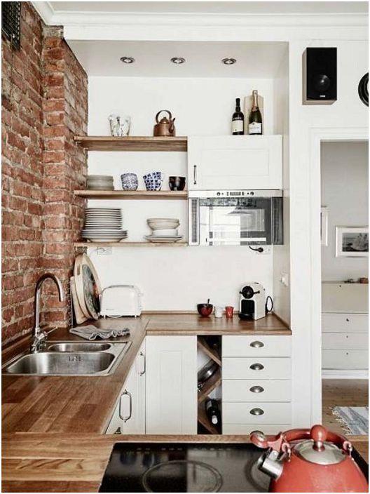 Добър вариант за декориране на U-образна кухня с зидария за стени.