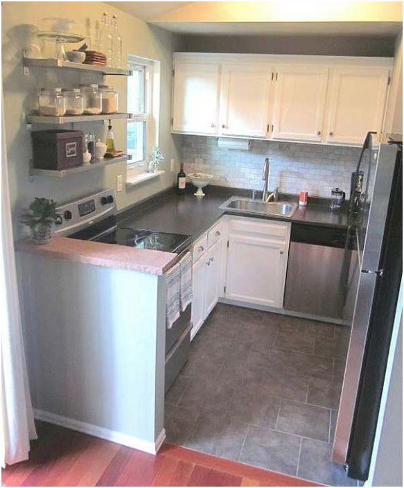 Хубав кухненски комплект в сиви тонове с U-образна форма.