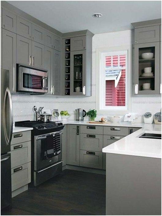 U-muotoinen keittiö harmaassa, valkoisessa ja mustassa on mitä pidät.