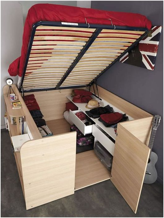 Bed, wardrobe and bookshelf in one piece of furniture