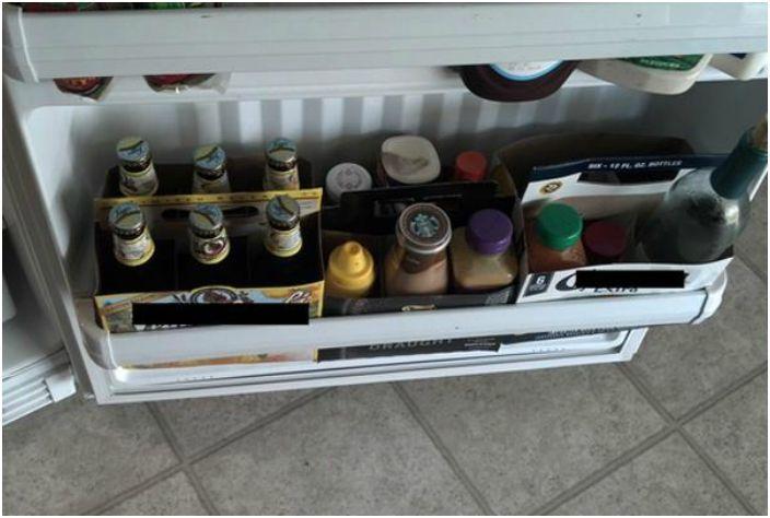 Хранение банок и бутылок в холодильнике.