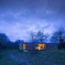 Liten moderne flatt takhus av ch + qs arquitectos-4