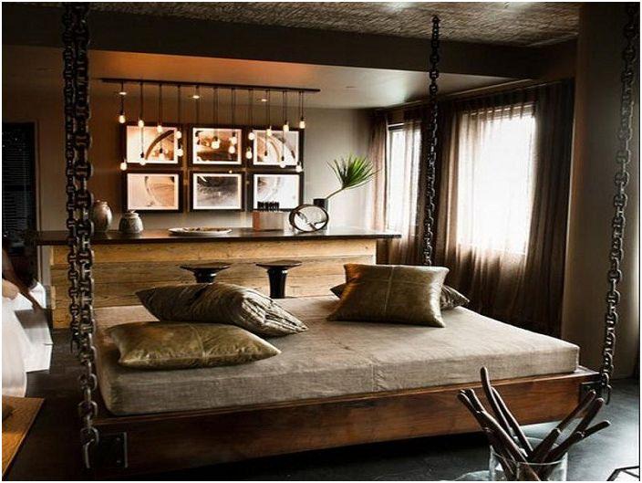 Piękna nowoczesna sypialnia ze stylowym wiszącym łóżkiem i fajnym oświetleniem.