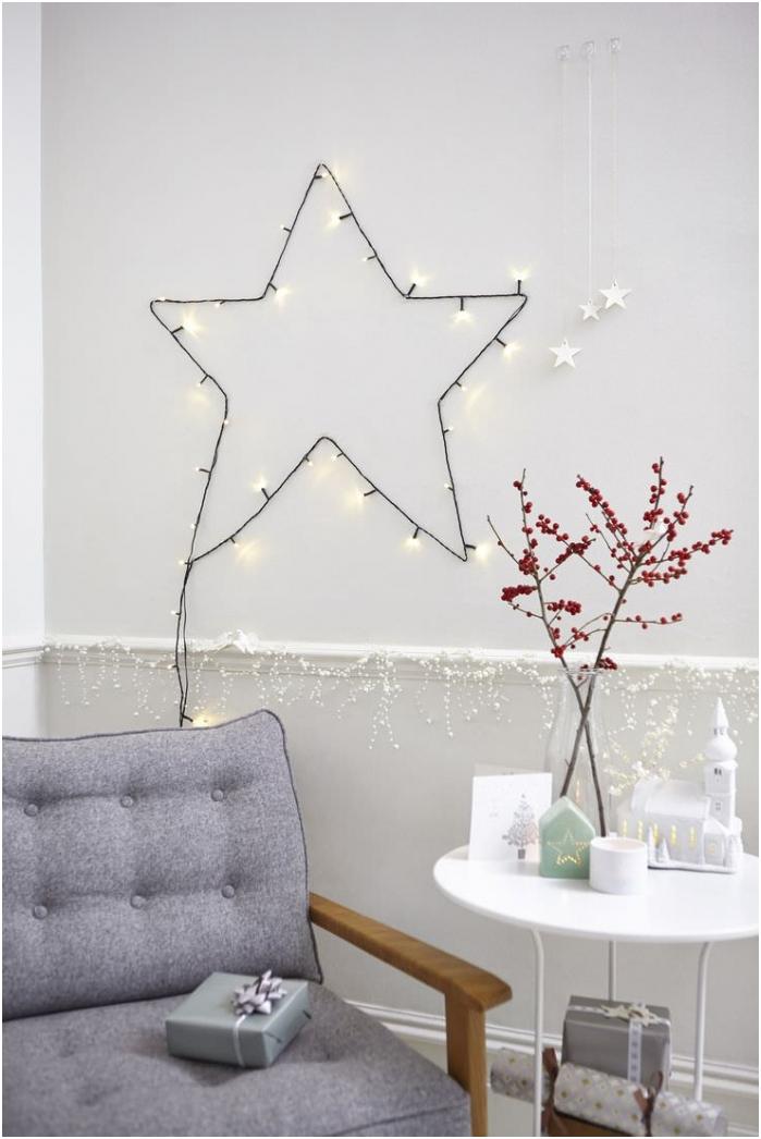 rysunek na ścianie w formie gwiazdy za pomocą girlandy