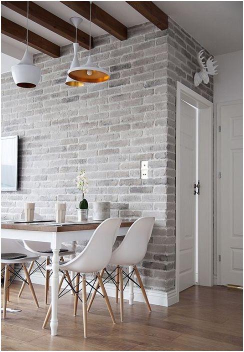 A szürke téglafal nagyszerű elem az otthon étkezőjének díszítésére.