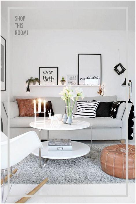 A világosszürke nappali jól felszerelt nagyon szép bútorokkal.