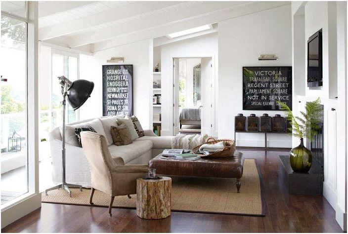 Ciekawe wnętrze salonu w kremowej, czekoladowej tonacji.