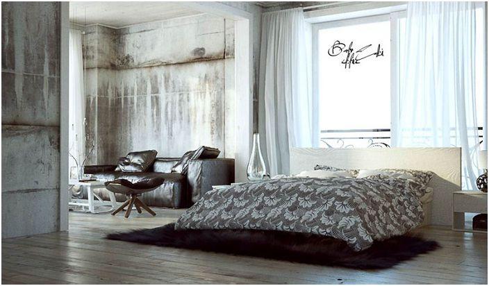 Неоцветените бетонни стени са комбинирани със сложни дизайнерски мебели, които характеризират стила на таванското помещение.