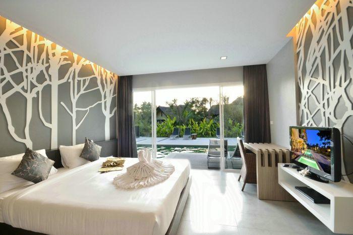 Oryginalna sypialnia ze wspaniałymi ścianami.