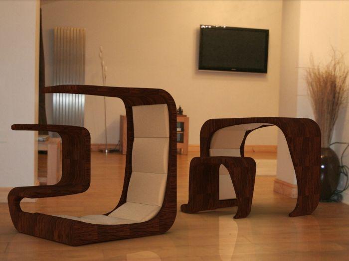 Този сложен куб може да бъде удобен стол с мини-маса или, ако е обърнат, маса и табуретка.