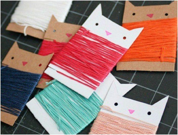 Джобни картонени шпули от картонена нишка под формата на котешки лица.