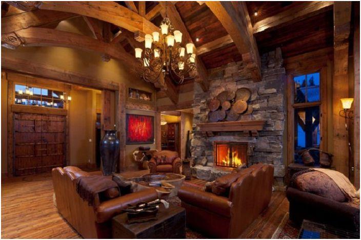 Комбинация от кожени мебели с дърво, допълнени от уютна каменна камина.