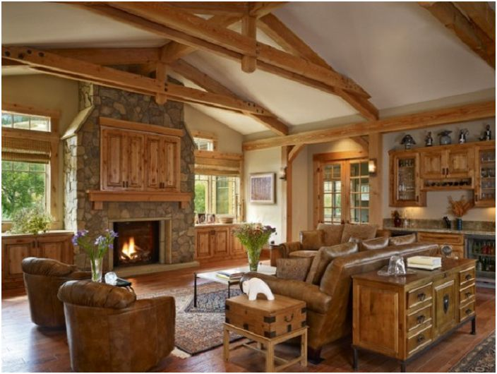 Комбинация от дървени мебели с каменна камина и отлична гледка от прозореца.