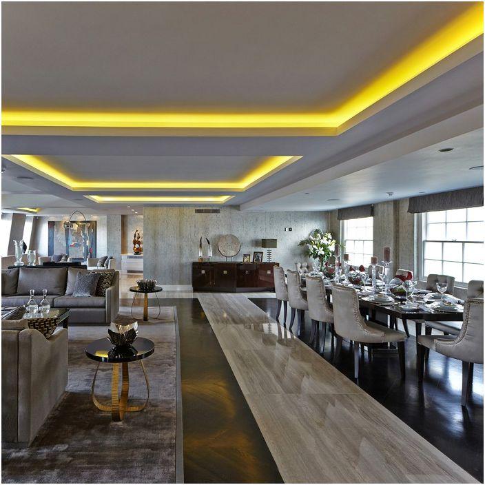 Salon z jadalnią - dwa w jednym. Praktyczne rozwiązanie, które zdobi niesamowite oświetlenie.