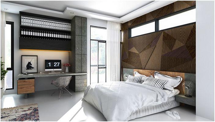 Абстрактните модели, които красят стената в спалнята, перфектно се вписват в интериора на стаята.