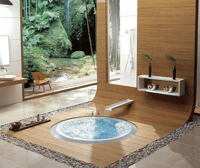 Малка кръгла вана, вградена в пода.