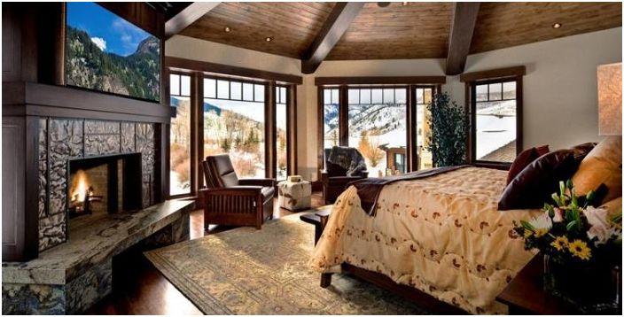 Уютна обстановка в спалнята с камина.