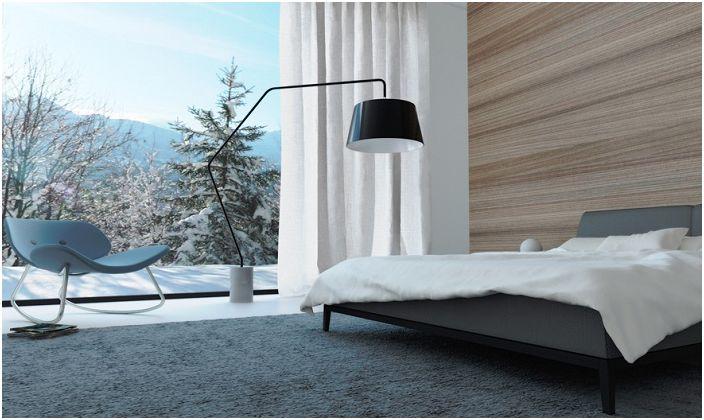 Спалня в минималистичен стил с красива зимна гледка от прозореца ще придаде вълшебно настроение.
