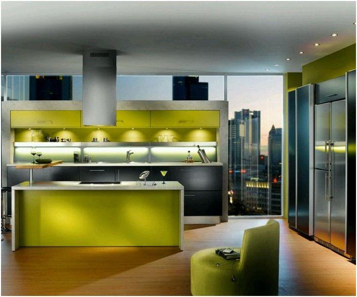 Зеленикавата кухня е декорирана в модерен стил.