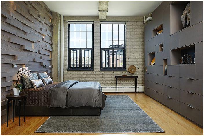 Спалнята в тъмносиви тонове разкрива всички тайни и специфики на индустриалния стил в интериора.