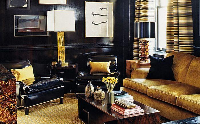 Olohuone kultaisissa ja mustissa sävyissä