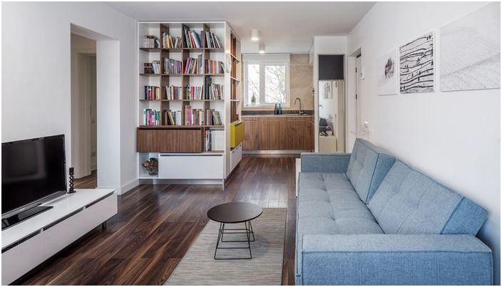Salon połączono z kuchnią, znalazło się miejsce na bibliotekę