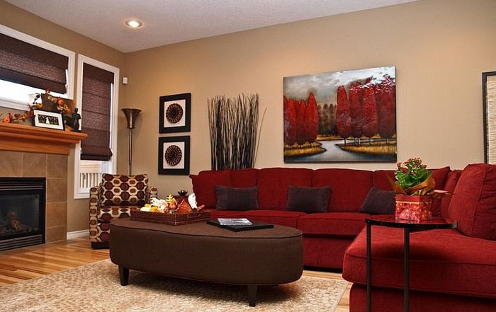 Red sofa - the compositional center of the living room