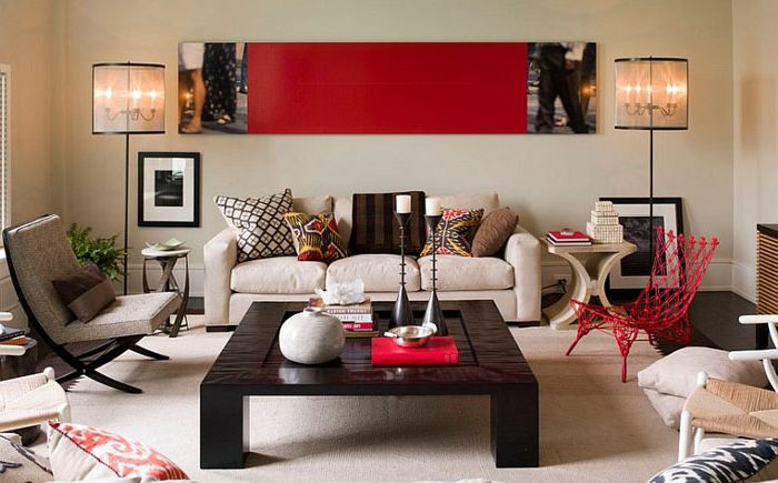 Contemporary living room with red accents by Thom Filicia