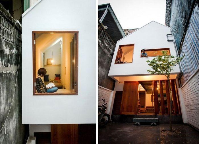 KN House - небольшой 2-этажный дом, построенный между двумя домами.