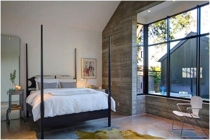 Красиво декорирана спалня с легло в модерен стил.