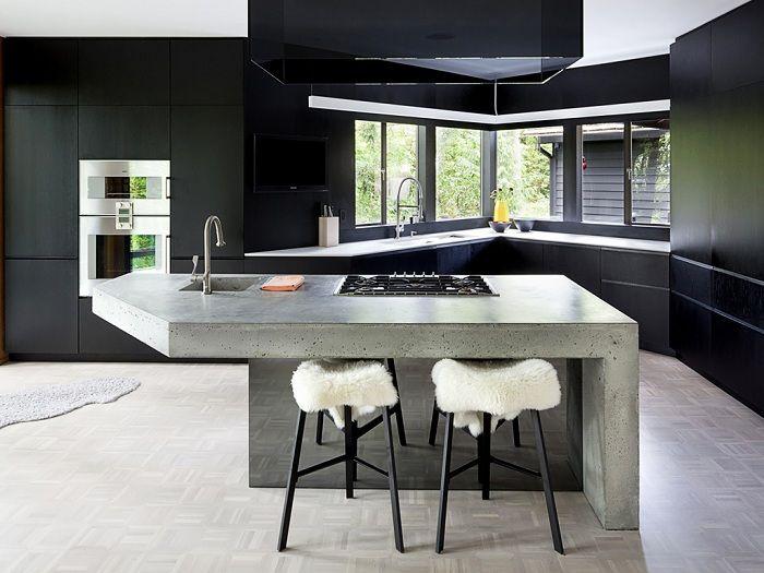 Бетон и 50 оттенков серого создают неповторимый брутальный интерьер современной кухни.