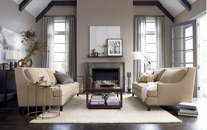 Если разместить симметрично два дивана в гостиной возможно создать больше места для развлечений.