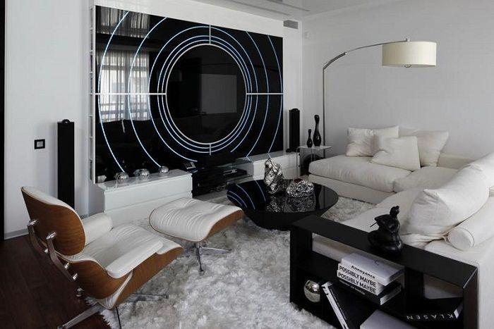Современный интерьер крохотной гостиной преображен за счет акцентной стены.