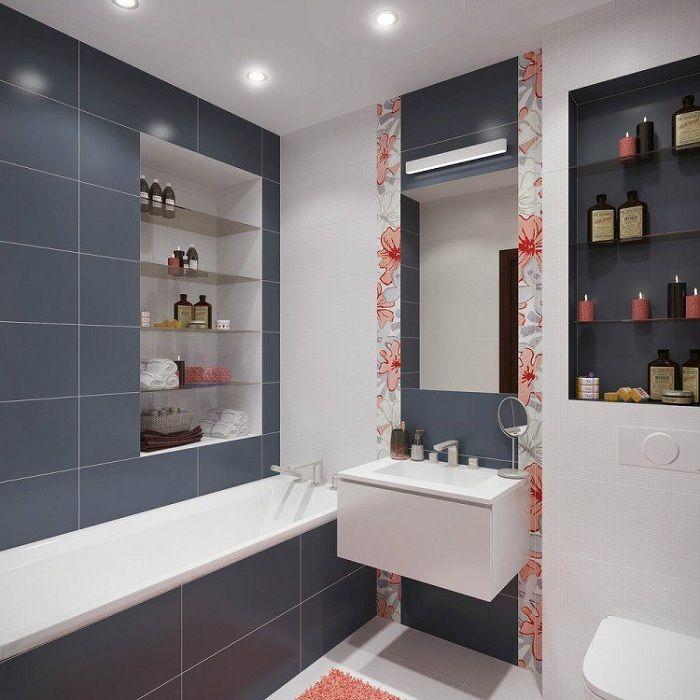 Интерьер ванной-комнаты преображен за счет цветных вставок на кафеле, что выглядят чудесно.
