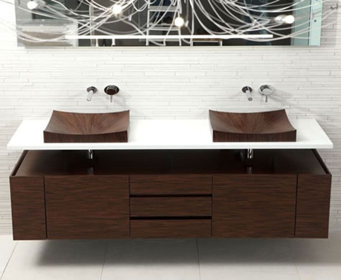 Оформление ванной комнаты парой оригинальных деревянных раковин, что впечатлят и создадут уютный интерьер.