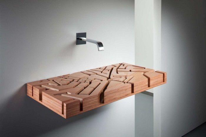 Оригинальный интерьер возможно создать с помощью такой интересной резной деревянной раковины.