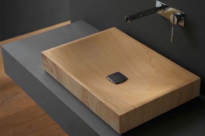 Дизайнерское решение создать классическую раковину выполненную из дерева, что понравится.
