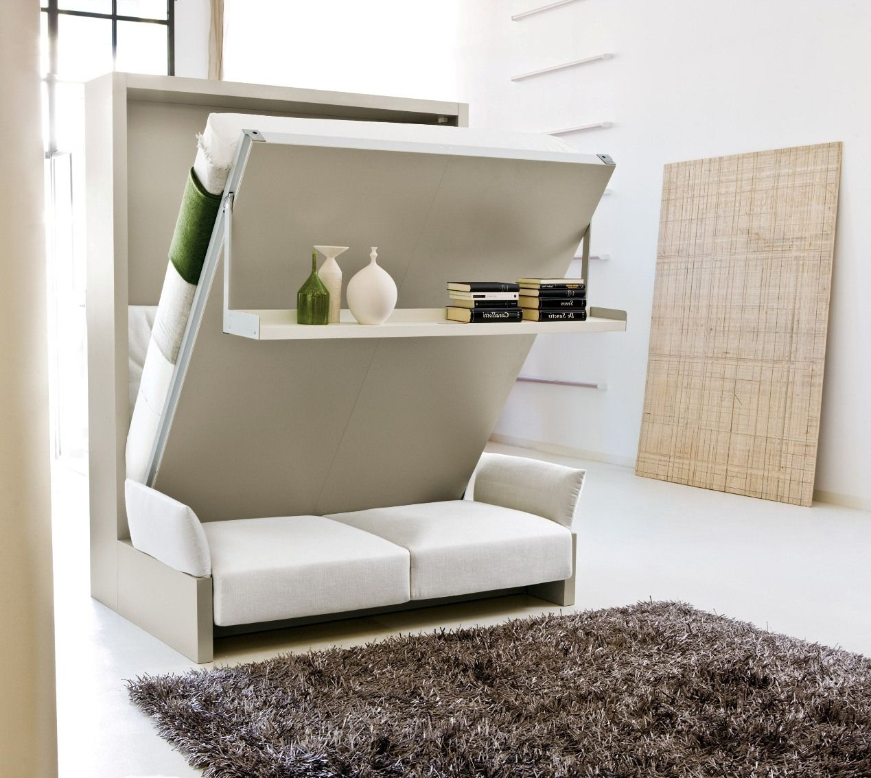 Трансформирующийся диван в стену