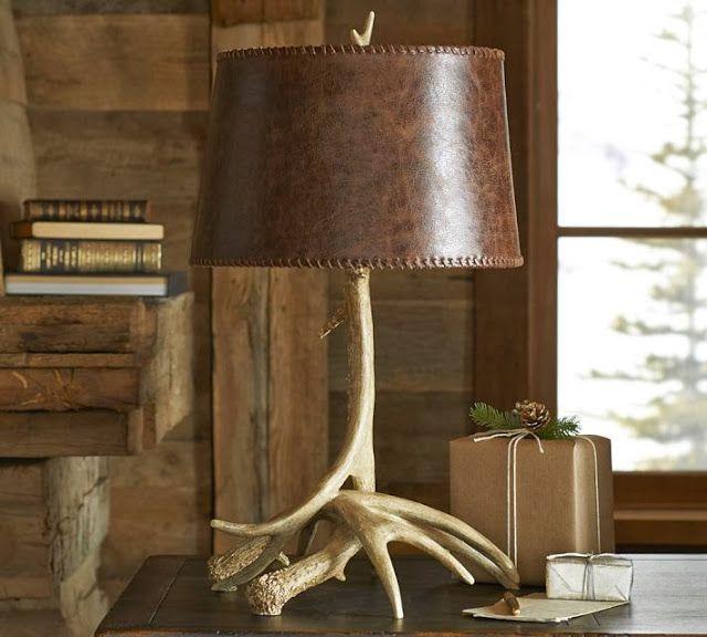 Кожаный флакон настольной лампы как акцентная деталь интерьера