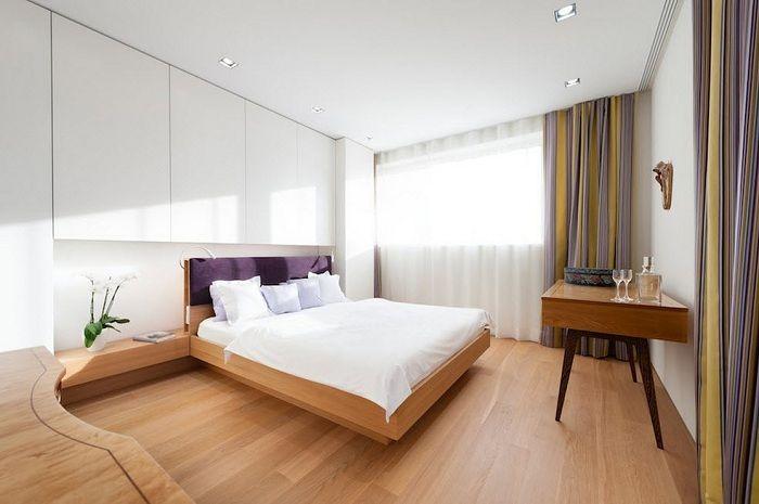 При оформлении спальни стоит обращать внимание на мебель, но важным является и правильное освещение.
