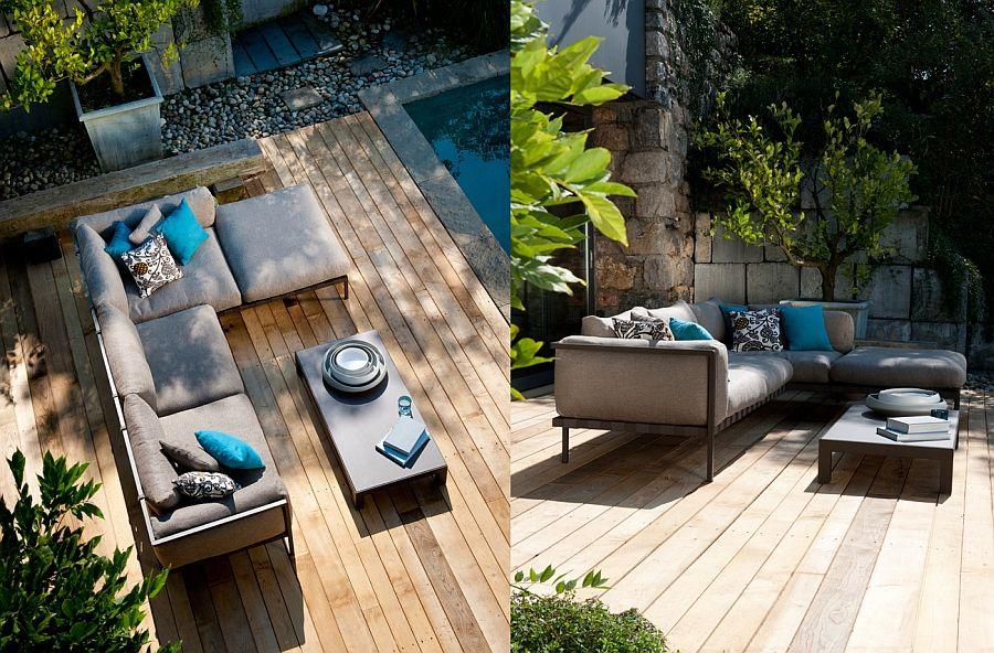 Fantastisk sofa, bord på bassengterrassen med dekorative elementer