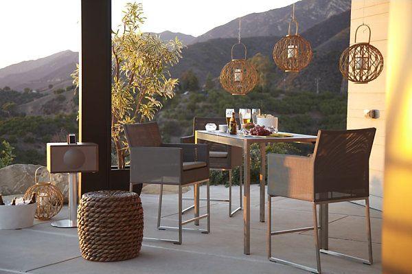 Дизайнерский столик, светильники, тумба и стулья на террасе