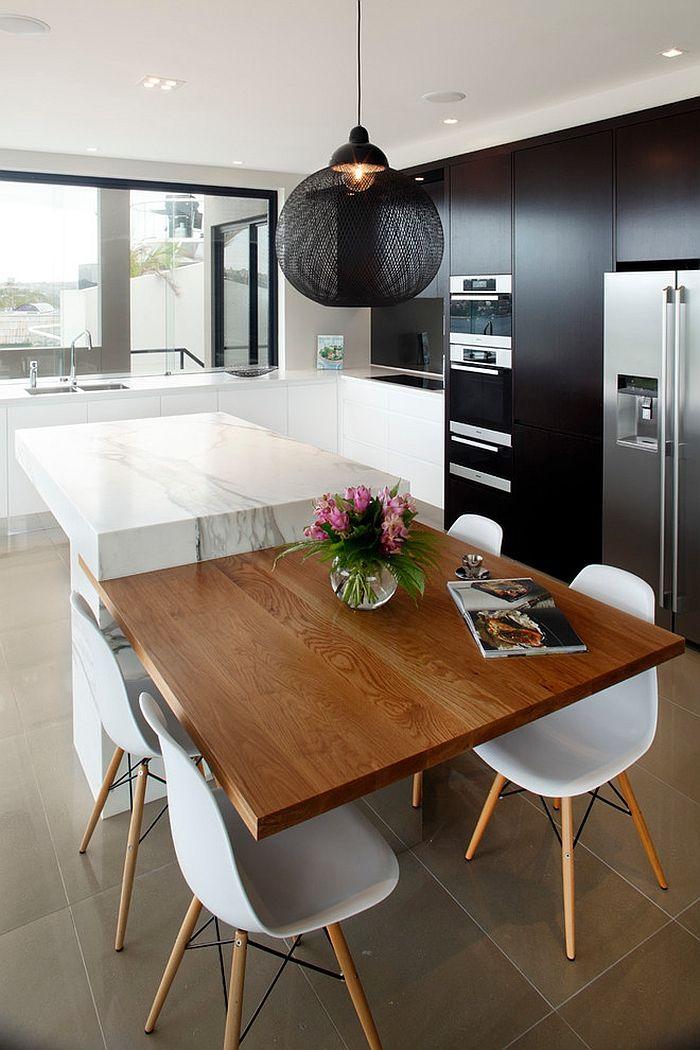 Подвесной светильник с черным абажуром на кухне