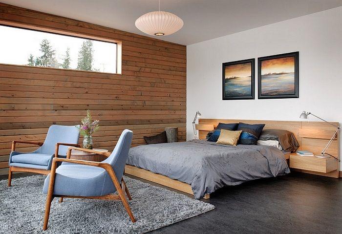 Потрясающий интерьер спальной обустроен благодаря размещению в ней крутой кровати на платформе.