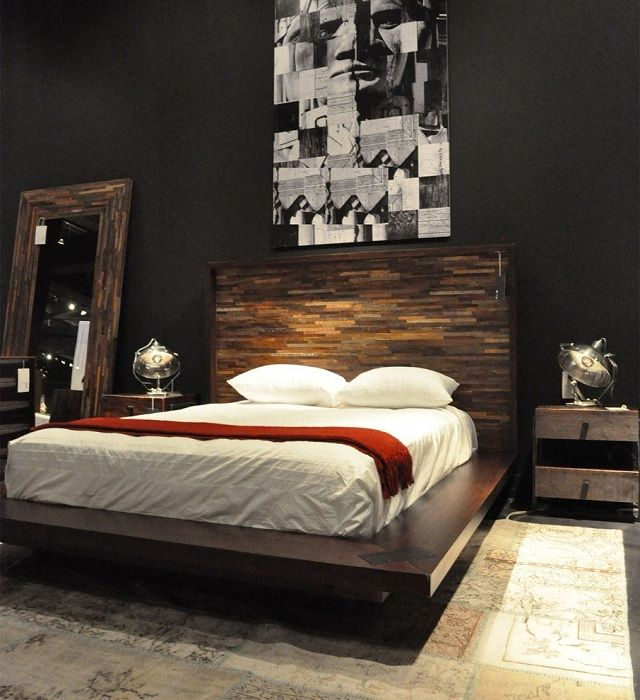 Практичная идея декорировать интерьер спальной в темных оттенках.