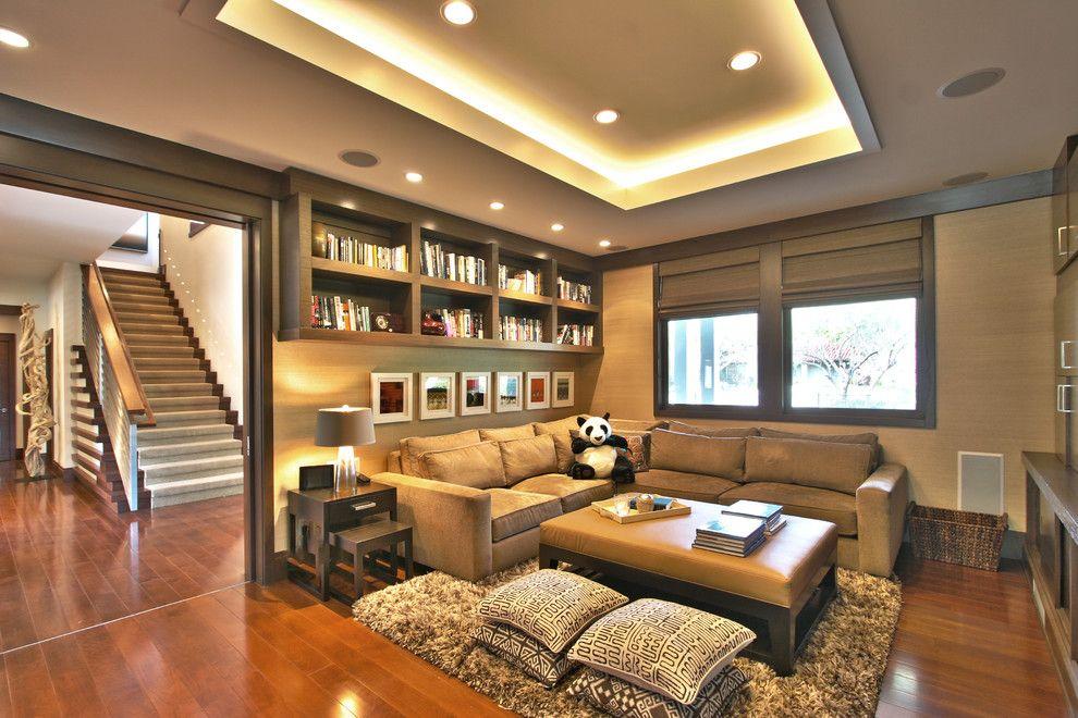 Потолочные светильники в интерьере гостиной комнаты