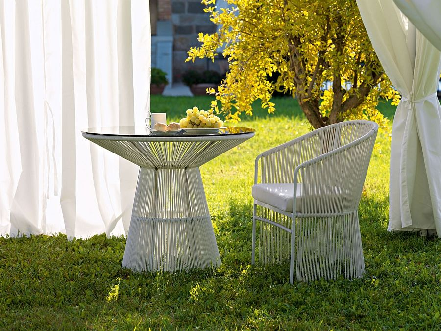 A table with a chair in the garden