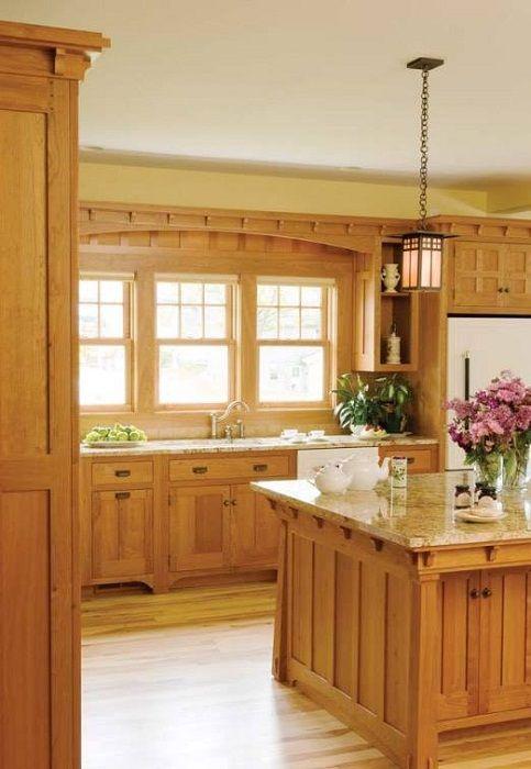 Кухнята е декорирана в дърво, уютно и необичайно решение.